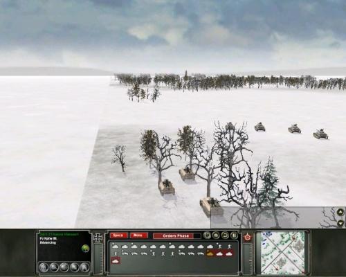 Fanteria meccanizzata e carri in viaggio verso l'obiettivo, il villaggio che si intravede in lontananza.