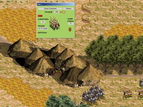 Truppe libiche (fanti e cavalieri) in colonna attraversano un villaggio lontano dalla prima linea.